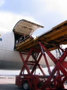 Loading plastic export pallets into a cargo plane