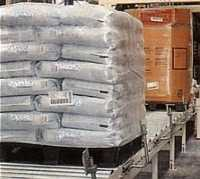 Plastic pallets with bags on a conveyor